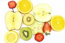 Apple kiwi star fruit orange lemon strawberry slice on white background fruit art
