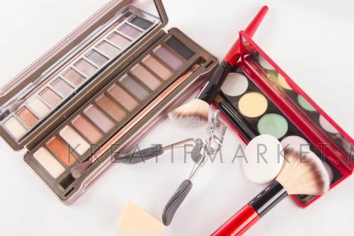 Set of decorative cosmetics on light colorful background