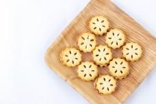 few macaron cookies arrange nicely on a woorden plate