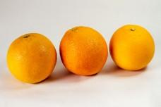 3 fresh oranges on isolated white background