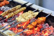 Chicken Lamb Beef Mixed Kebab tikka kabab on charcoal flame grill